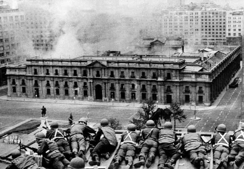 Troops and planes bomb the presidential palace during the 1973 military coup in Chile against an elected socialist government.