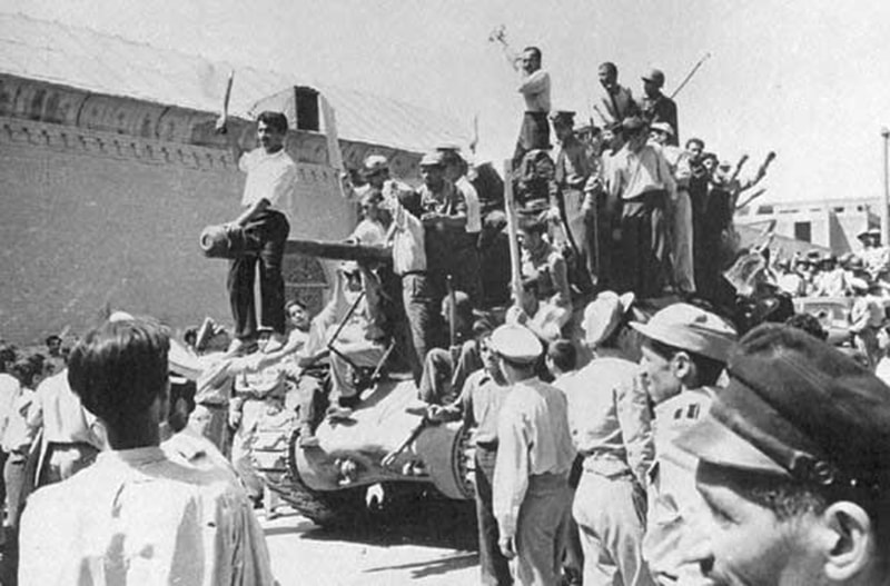 Pro-monarchy supporters celebrate the 1953 military coup in Iran.