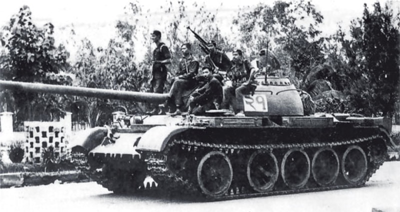 A tank parked outside the resident of the deposed Bangladeshi PM who was assassinated during the 1975 coup.