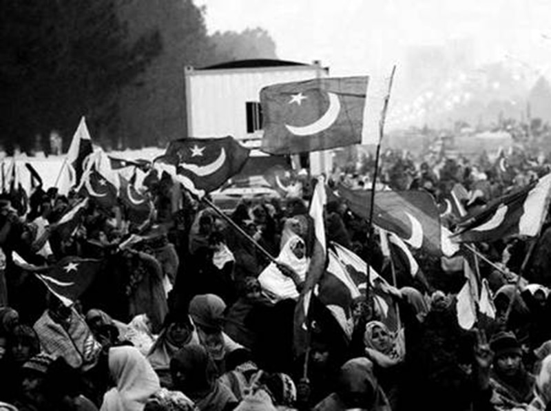 People in Lahore celebrate the 1958 military coup in Pakistan.