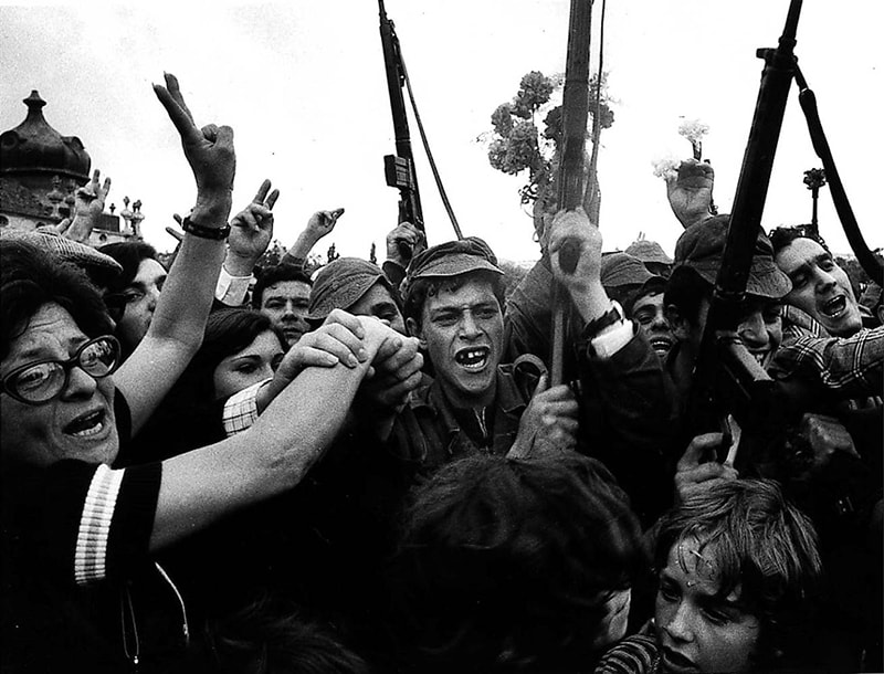 People in the Portuguese capital, Lisbon, celebrate the coup.