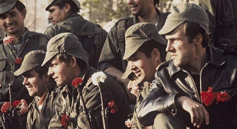 Soldiers relax after the fall of the dictatorship.
