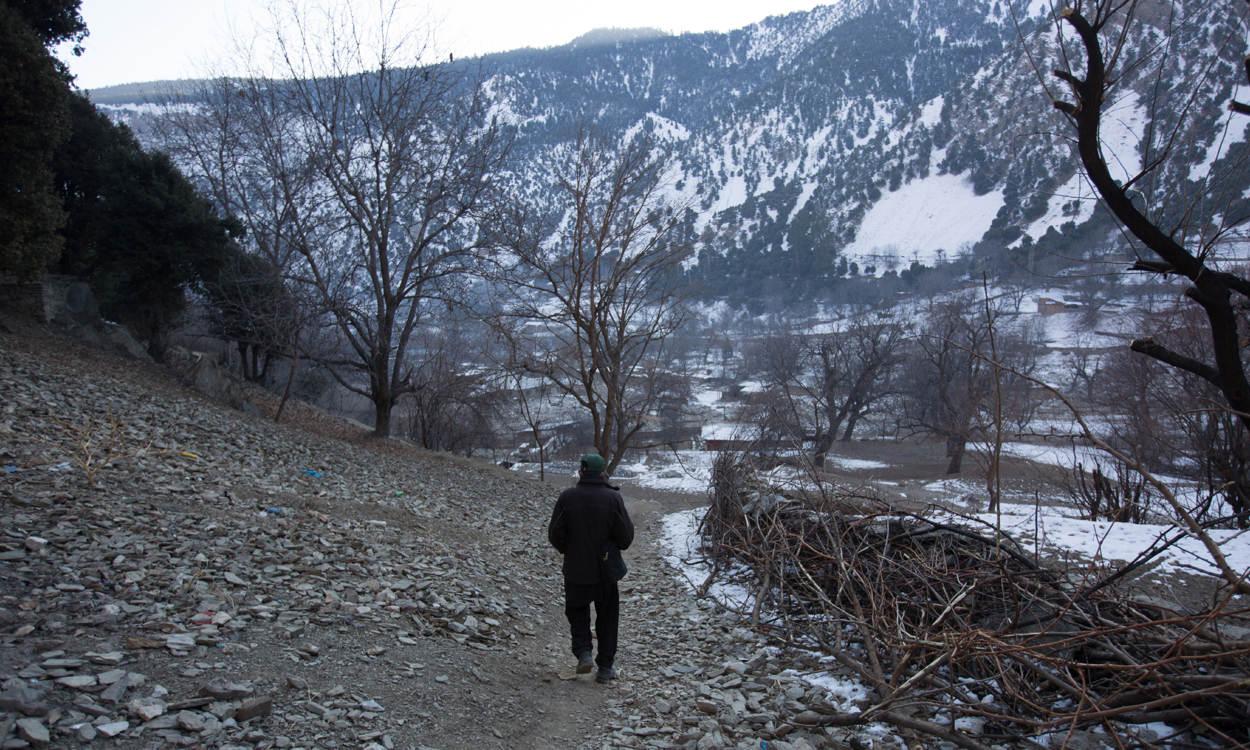 A boy walks through a village in Kalash valley | Photos by Danial Shah