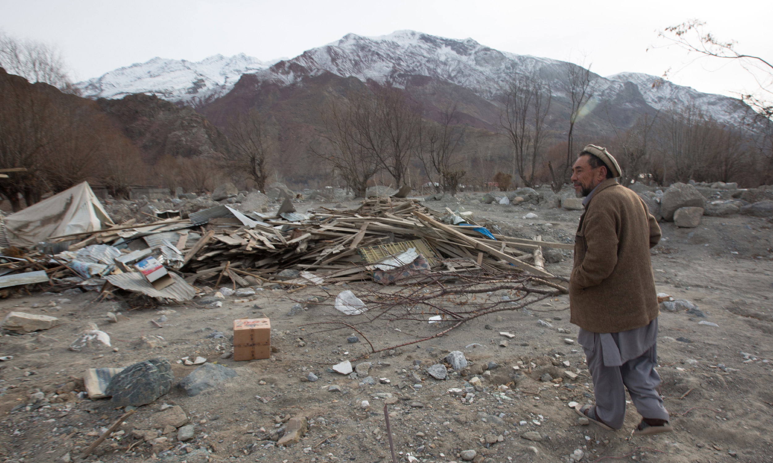 Mohiuddin who lost his home in a flood in Reshun Gol village