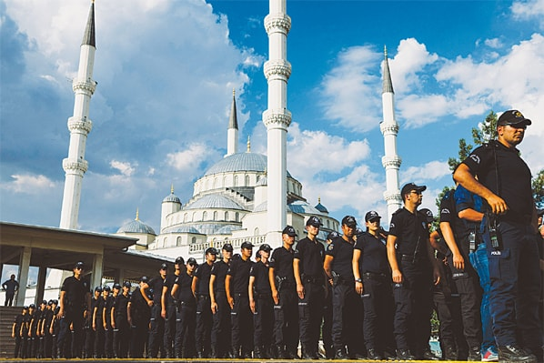 ANKARA: Turkish policemen attend the funeral at the Kocatepe mosque on Thursday of special forces officer Meric Alemdar who was killed during the failed July 15 coup.—AFP