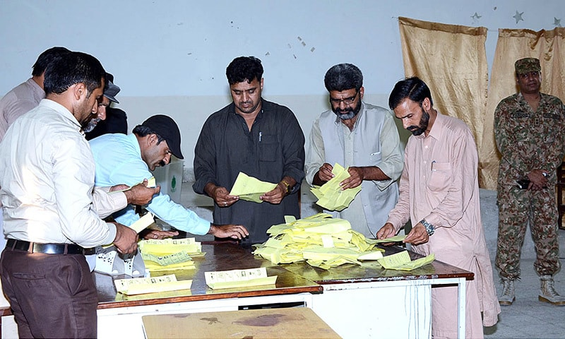MUZAFFARABAD: Presiding officers begin counting of votes after completion of balloting at a polling station on Thursday.—APP