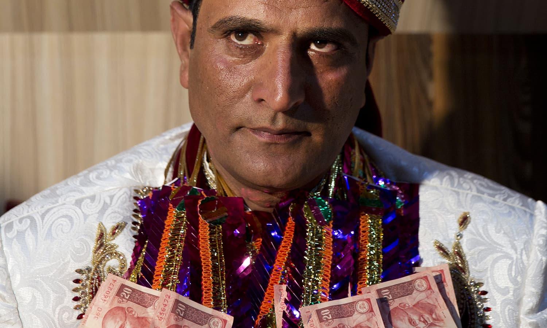 Groom Shiekh Naseer Ahmed during his wedding ceremony in Srinagar.— AP