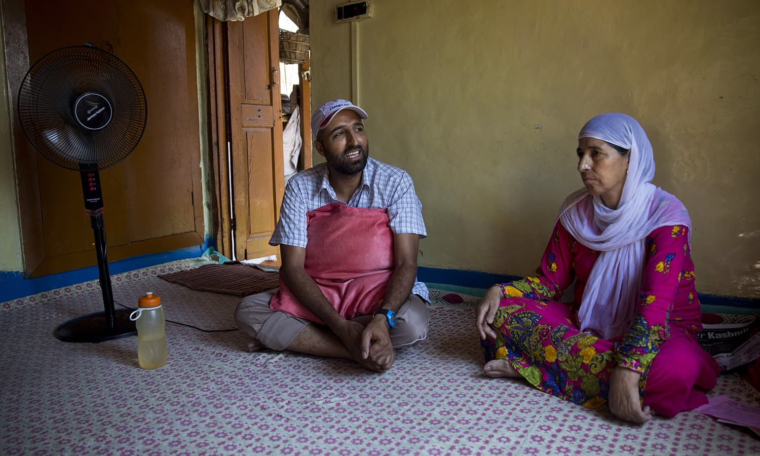 Cancer patient haleema banoo and her son reyaz ahmed speak to the associated press inside their