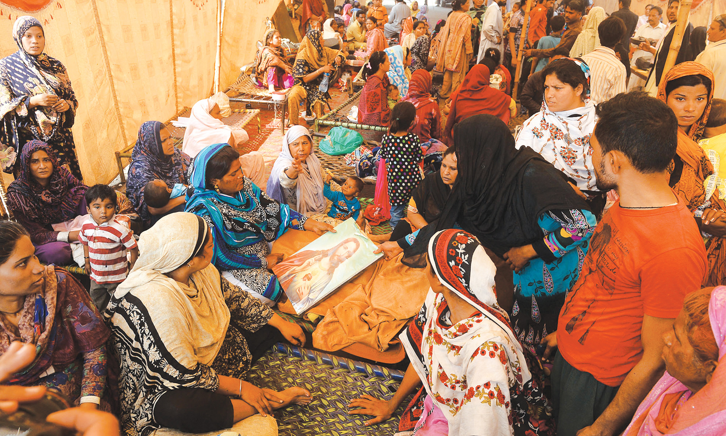 Christian women mourn after the Jospeh Colony attack in Lahore in 2013 | M Arif, White Star
