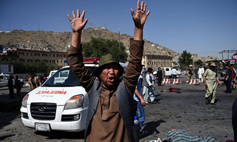An Afghan protester screams near the scene of the suicide attack. —AFP