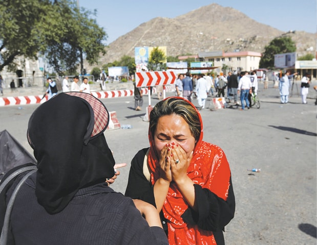 KABUL: An Afghan woman weeps at the site of a suicide attack here on Saturday.—Reuters