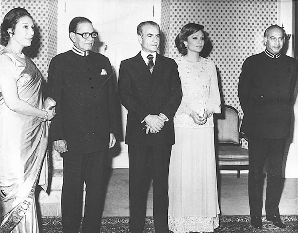 Mohammad Reza Shah Pahlavi of Iran (centre), with Zulfikar Ali Bhutto (extreme right) and Begum Nusrat Bhutto (extreme left) in Rawalpindi. — Dawn Library
