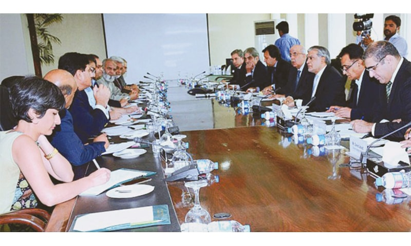 Finance Minister Ishaq Dar chairing a meeting to review progress of the Dassu Hydro Power Project on July 14, Islamabad.—APP