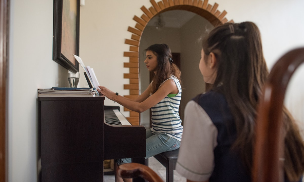 Natasha Humera Ejaz gives singing lessons to a young student| Mohammad Ali, White Star