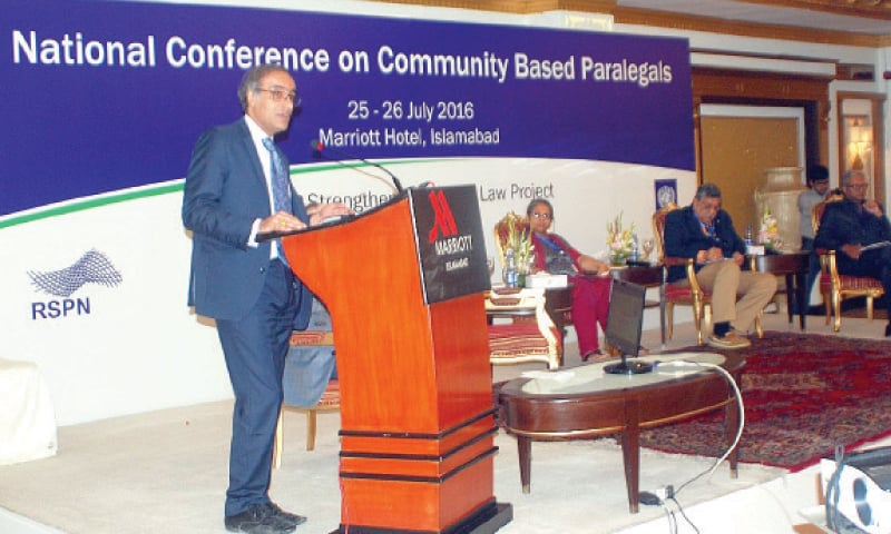 Law and Justice Commission of Pakistan Secretary Sarwar Khan speaks at the conference on Monday. — INP