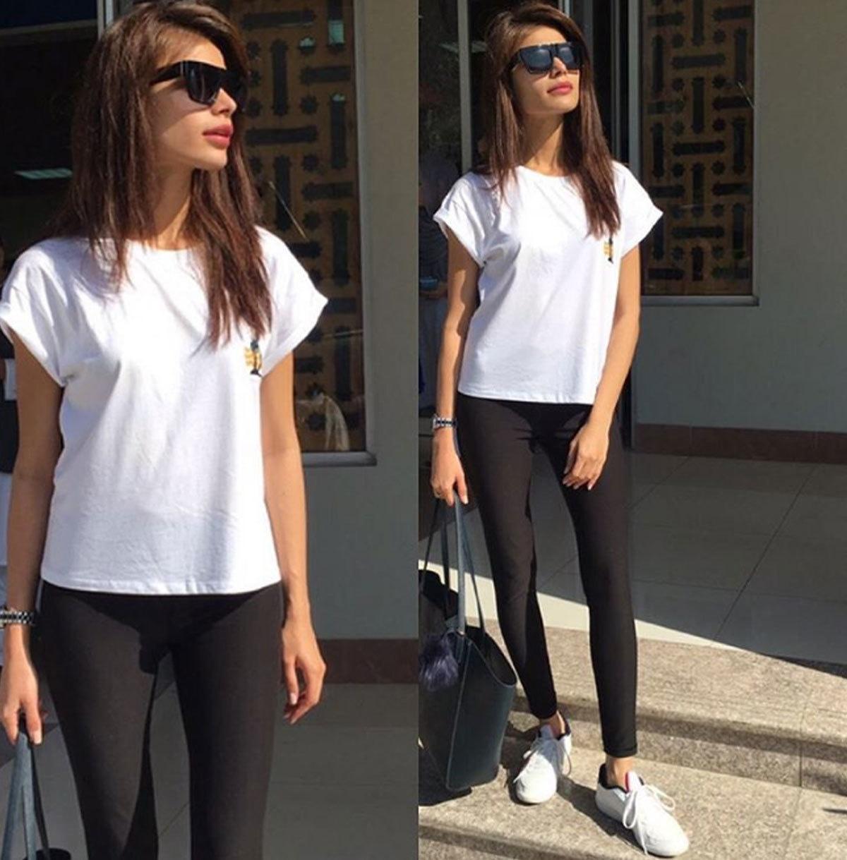 Sadaf Kanwal in white sneaks and shirt, ready to go anywhere