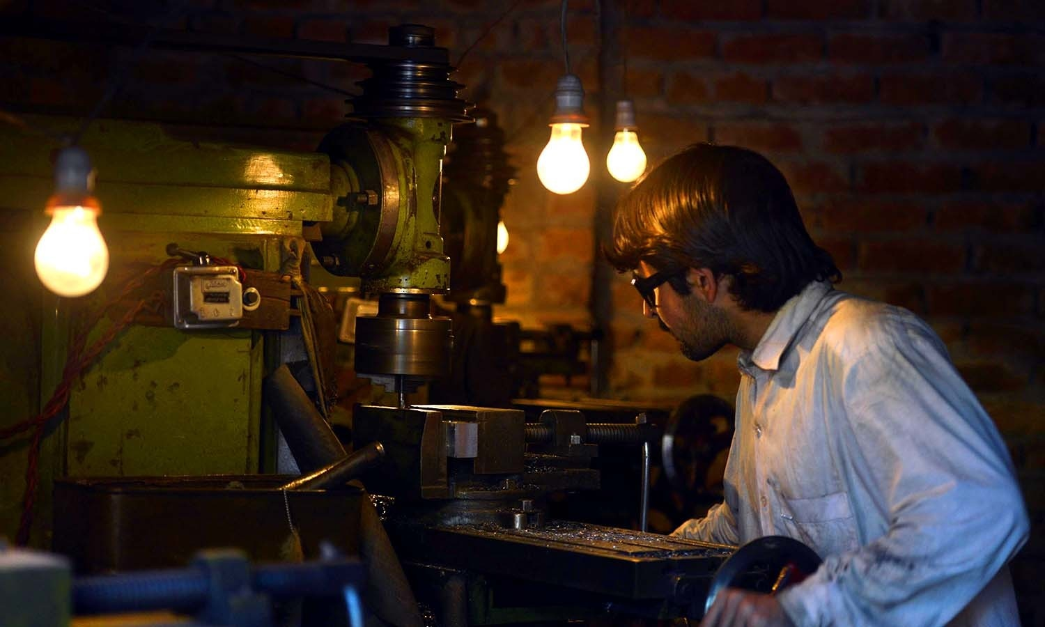A gunsmith uses a lathe at a small workshop. ─AFP