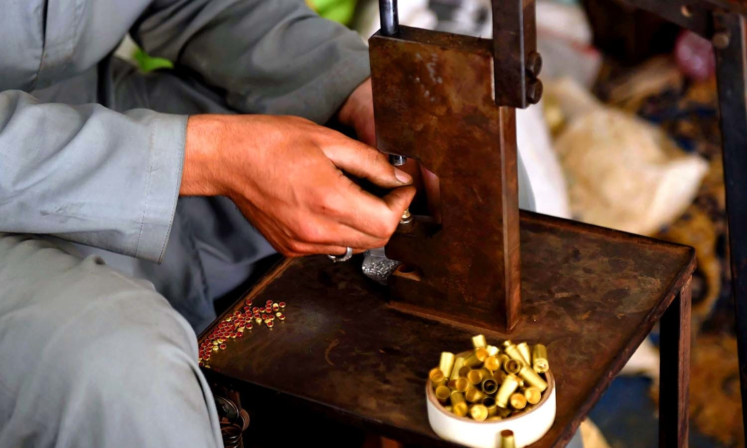 A gunsmith makes bullets. ─AFP