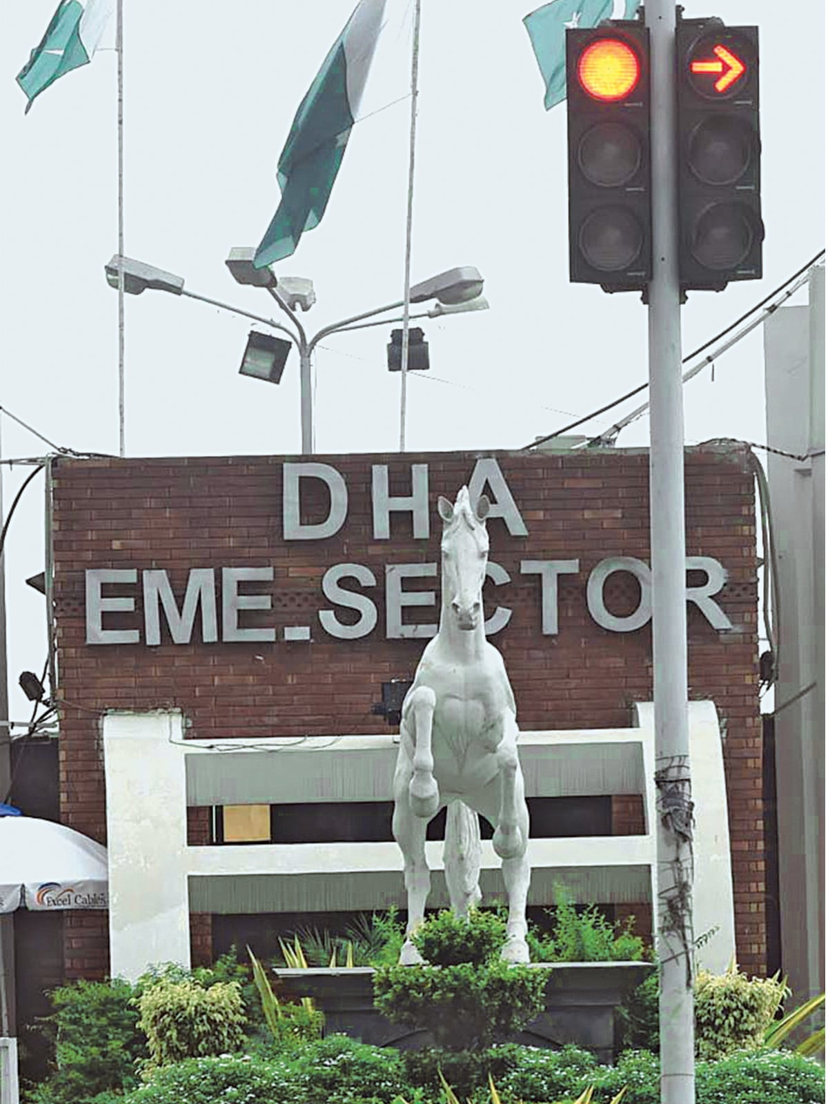 The entrance to DHA EME sector in Lahore | Arif Ali, White Star