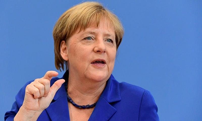 German Chancellor Angela Merkel gestures during a press conference in Berlin.─AFP