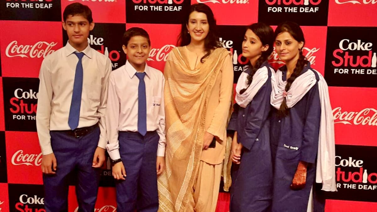 Zeb Bangash with students of the Deaf Reach school
