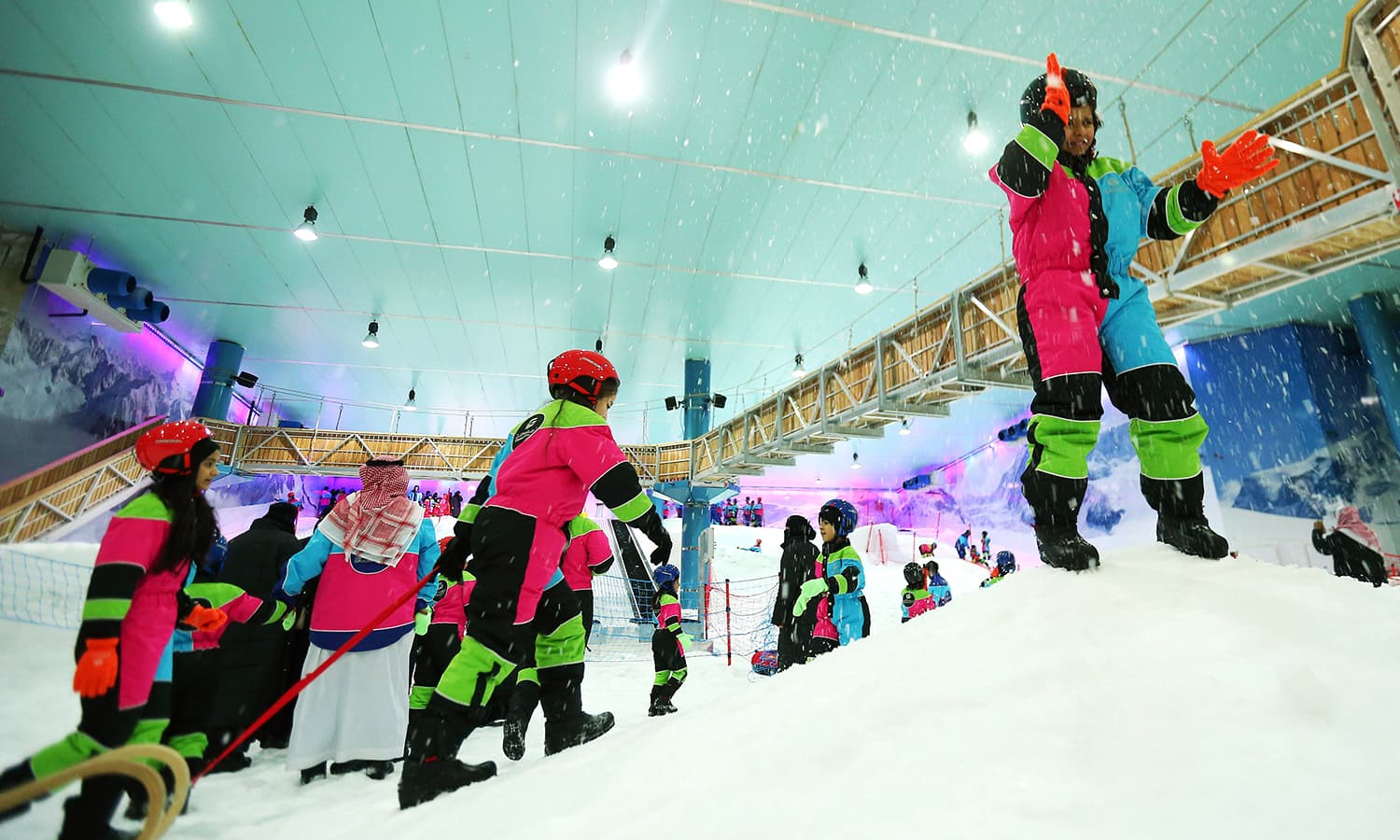 """This file photo taken on July 20, 2016 shows Saudis playing at the indoor snow theme park """"Snow City"""" in the Al-Othaim Mall Rabwa in the capital Riyadh. ─ AFP"""