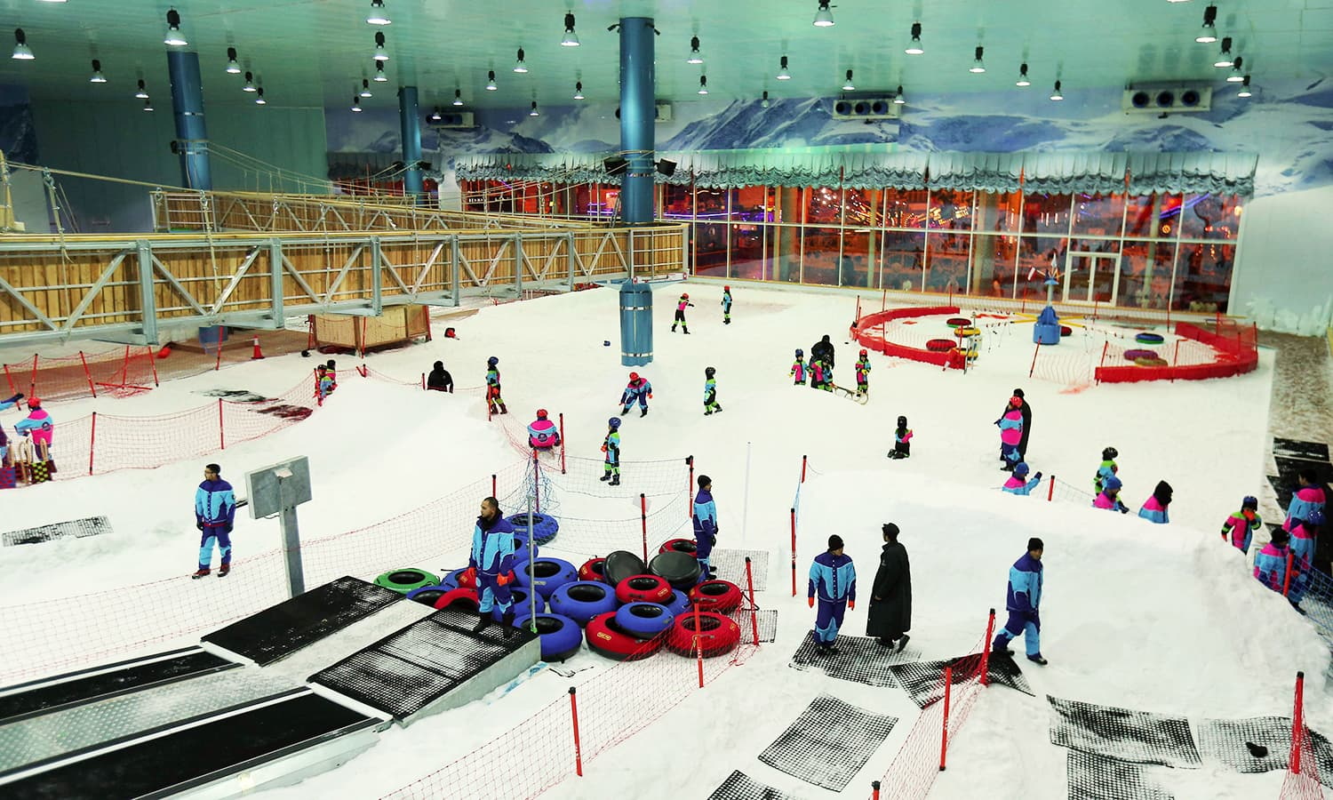 """This file photo taken on July 20, 2016 shows a general view of Saudis playing at the indoor snow theme park """"Snow City"""" in the Al-Othaim Mall Rabwa in the capital Riyadh. ─ AFP"""