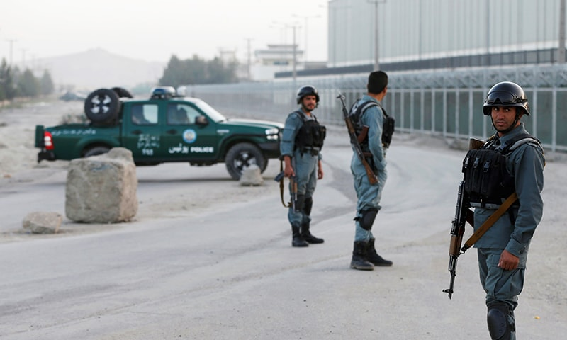 Afghan policemen keep watch near the site of a bomb blast in Kabul, Afghanistan August 1.— Reuters