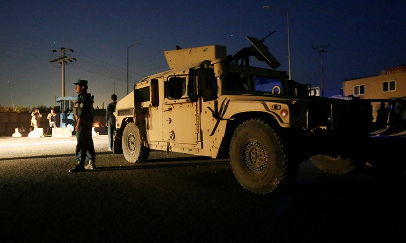 Afghan policemen keep watch near the site of a blast in Kabul, August 1.— Reuters
