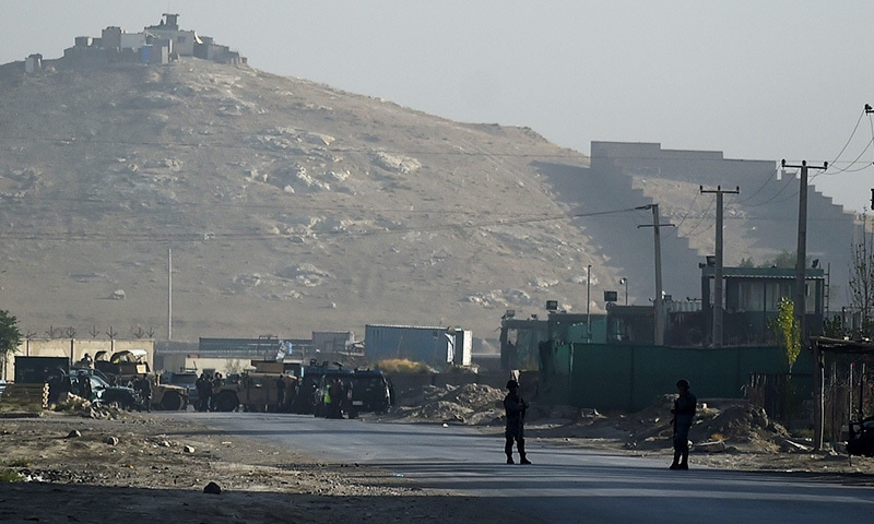 Afghan security forces stand guard near the blast site.— AFP