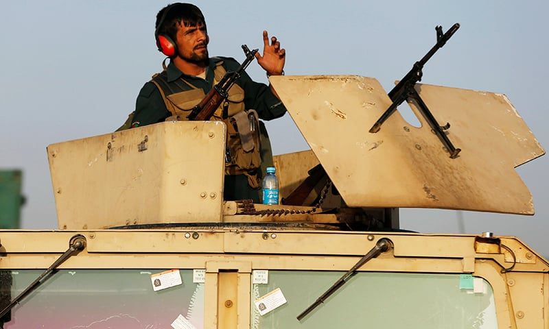 An Afghan policeman keeps watch near the site of a bomb blast in Kabul, Afghanistan August 1.— Reuters