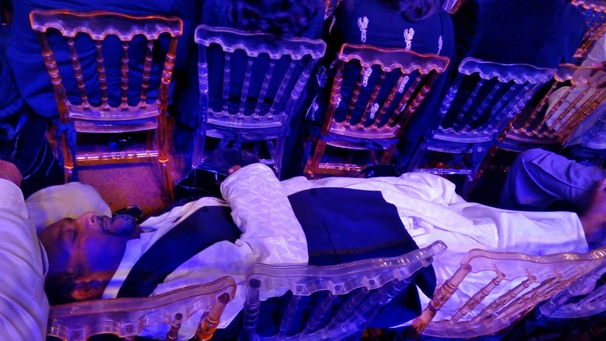 This happened. The show went on so long that a member of Amjad Sabri's troupe decided to take a nap.
