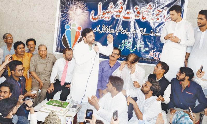 MUTTAHIDA Qaumi Movement leader Dr Aamir Liaquat Hussain is making a point at a mushaira held at Karachi University's Arts Lobby on Tuesday. Senior MQM leader Dr Farooq Sattar is also present.—PPI