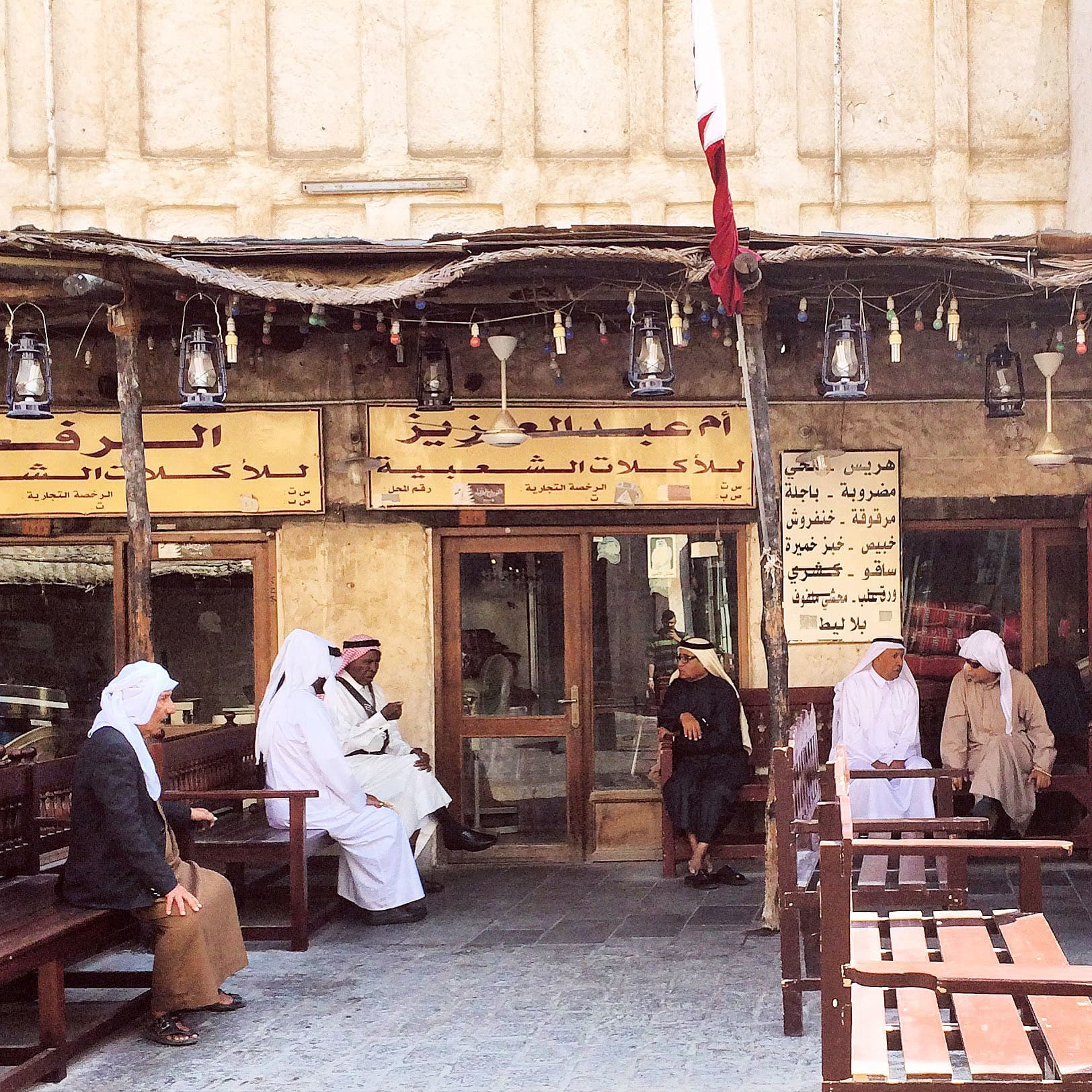 Locals having a chitchat at the Souq Waqif.