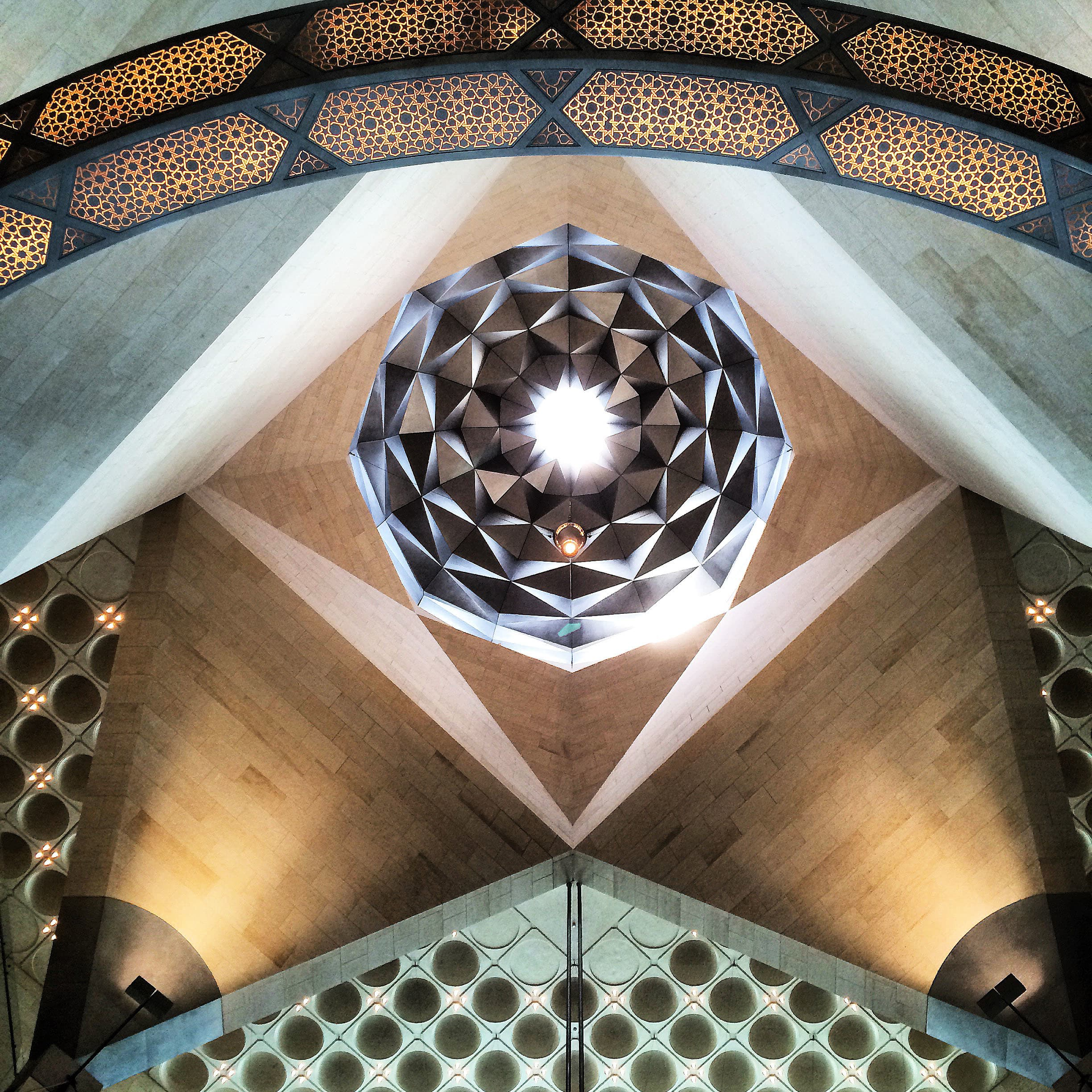 The interior of the museum is as spectacular as its exterior. This here is an oculus at the top of the atrium; it captures and reflects patterned light due to its faceted dome.