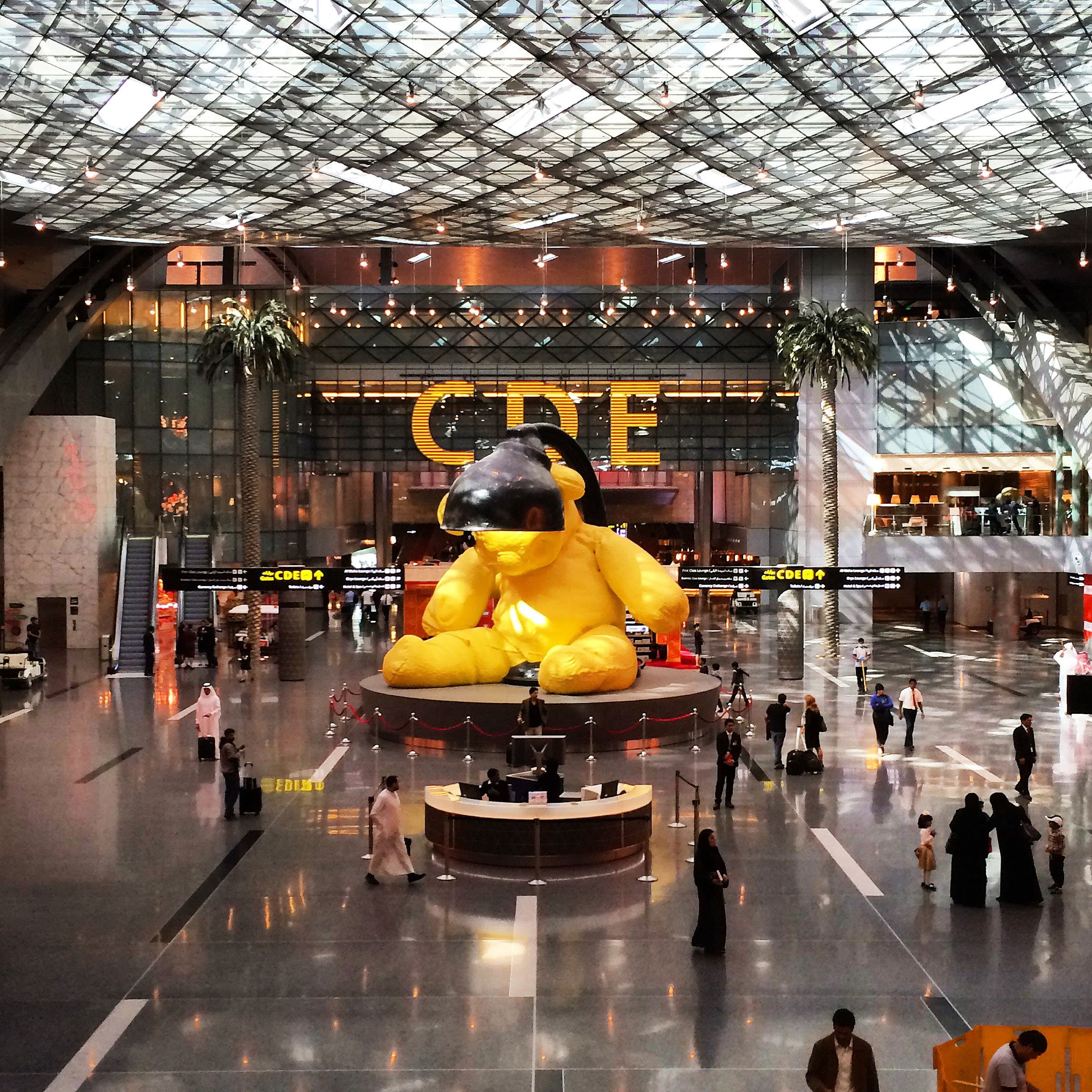A giant yellow lamp bear greeted me at Qatar's Hamad International Airport.
