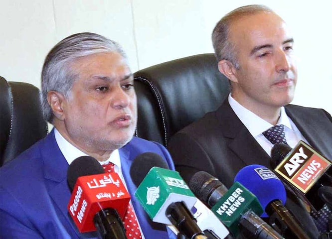 DUBAI: Finance Minister Ishaq Dar and IMF Mission Chief Harald Finger address a press conference on Thursday.