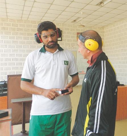 Shooter Ghulam Mustafa Bashir with coach Vladimir Kovalenko