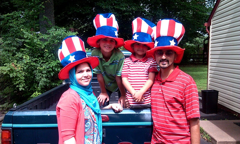 Atif, pictured with his family outside their home on the fourth of July, canvasses the state of Virginia in a bid to combat the vitriol directed towards American Muslims in the US election 2016. — Photo by writer