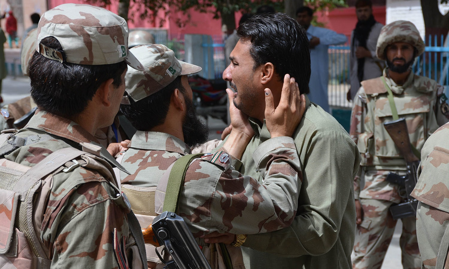A soldier comforts a mourner after the killing of a victim in a bomb explosion at a government hospital premises in Quetta on August 8, 2016.—AFP