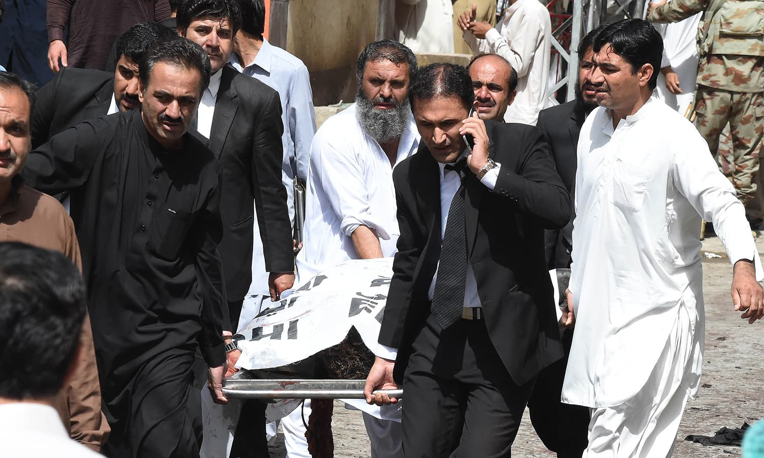 Lawyers carry the body of a colleague on a stretcher after a bomb explosion at a government hospital premises in Quetta on August 8, 2016.—AFP