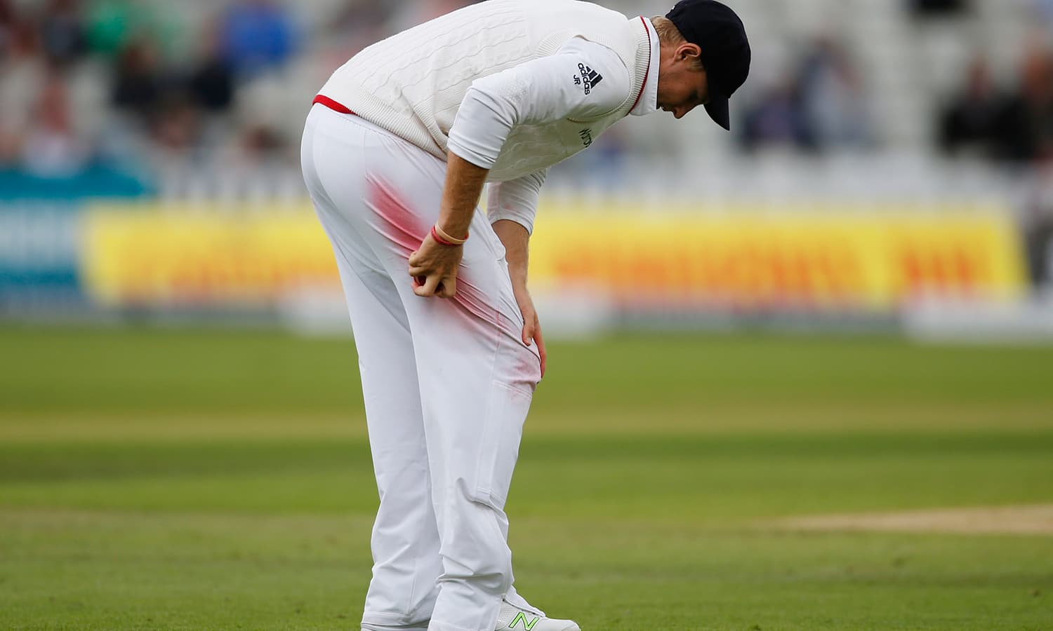 England's Joe Root shines the cricket ball during the match. — Reuters