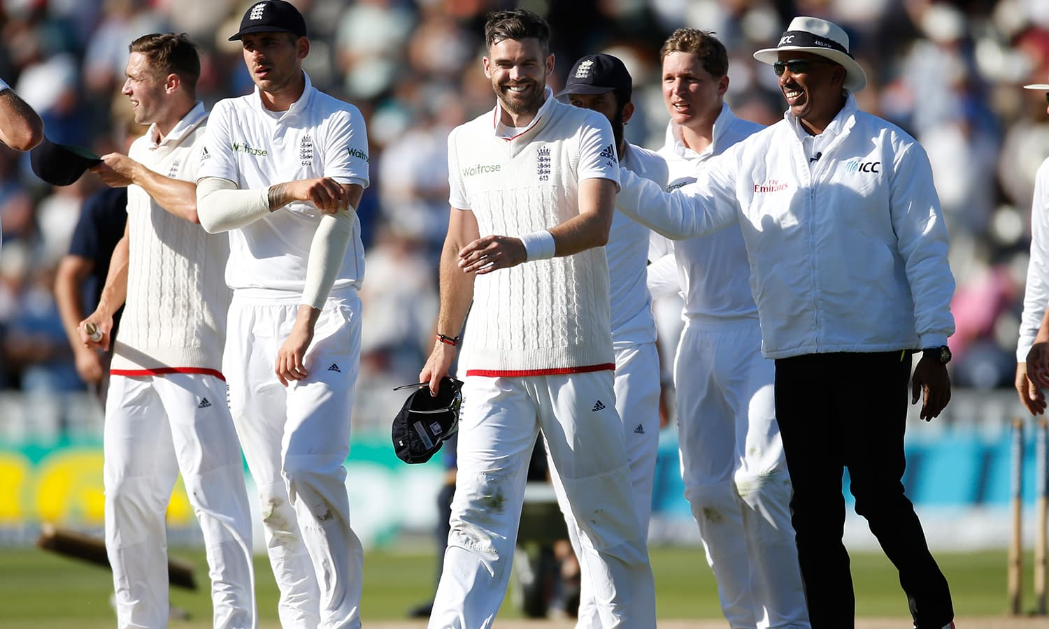 England's James Anderson and Umpire Joel Wilson after the match. — Reuters