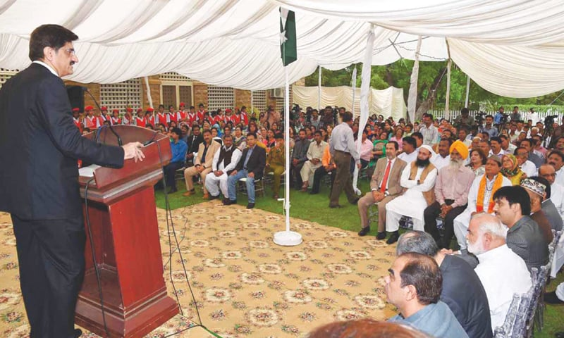 SINDH Chief Minister Syed Murad Ali Shah speaks at a gathering of minorities at the Holy Trinity Cathedral in Karachi on Thursday.—APP