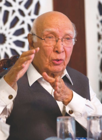 SARTAJ Aziz at the news conference.—AP