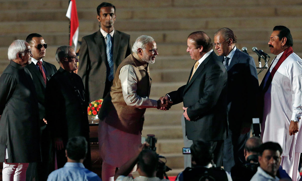 Indian Prime Minister Narendra Modi is greeted by his Pakistani counterpart Nawaz Sharif after Modi took the oath of office at the presidential palace in New Delhi. Also seen are India's President Pranab Mukherjee, Vice President Hamid Ansari, Sri Lanka's President Mahinda Rajapaksa Right and Mauritius Prime Minister Navinchandra Ramgoolam. | Reauters