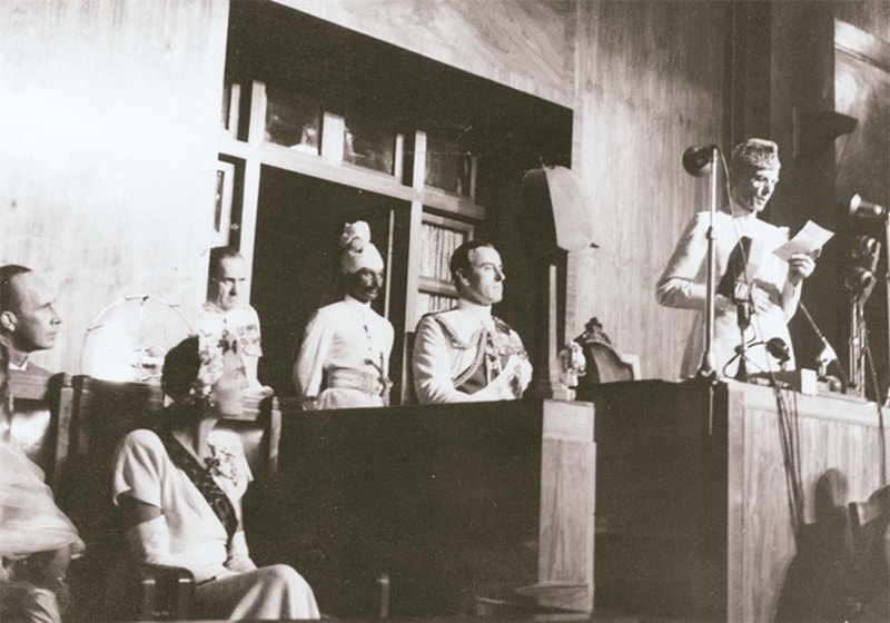 Quaid-i-Azam delivers a speech on August 14, 1947, in Karachi as Lord Mountbatten looks on.