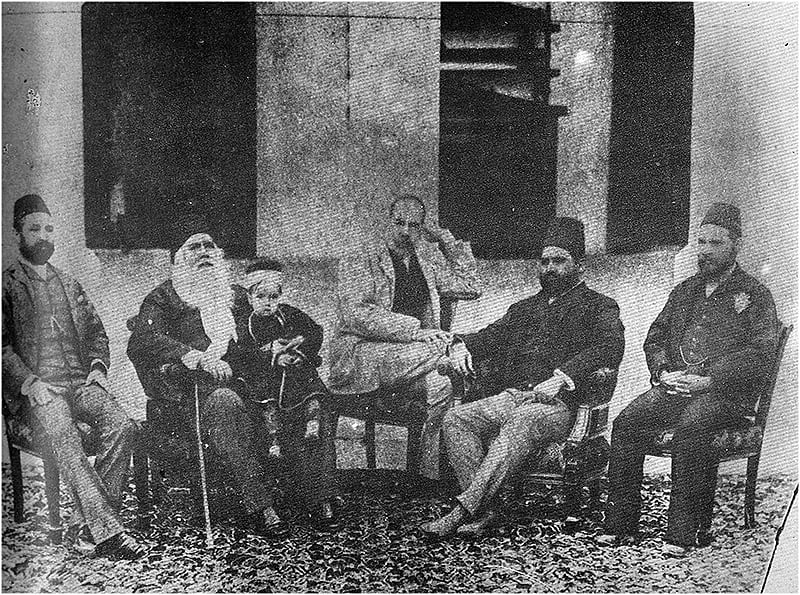 Sir Syed enjoys an evening at his home with a group of Muslim intellectuals. The child on his lap is his grandson.