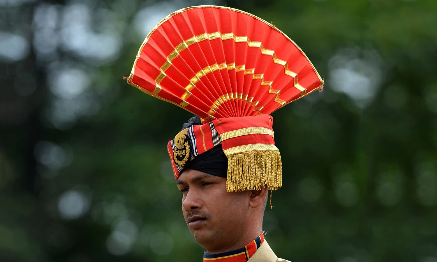 An Indian Border Security Force (BSF) soldier looks on during a celebrations marking Independence Day at The Bakshi Stadium in Srinagar , 2016. — AFP