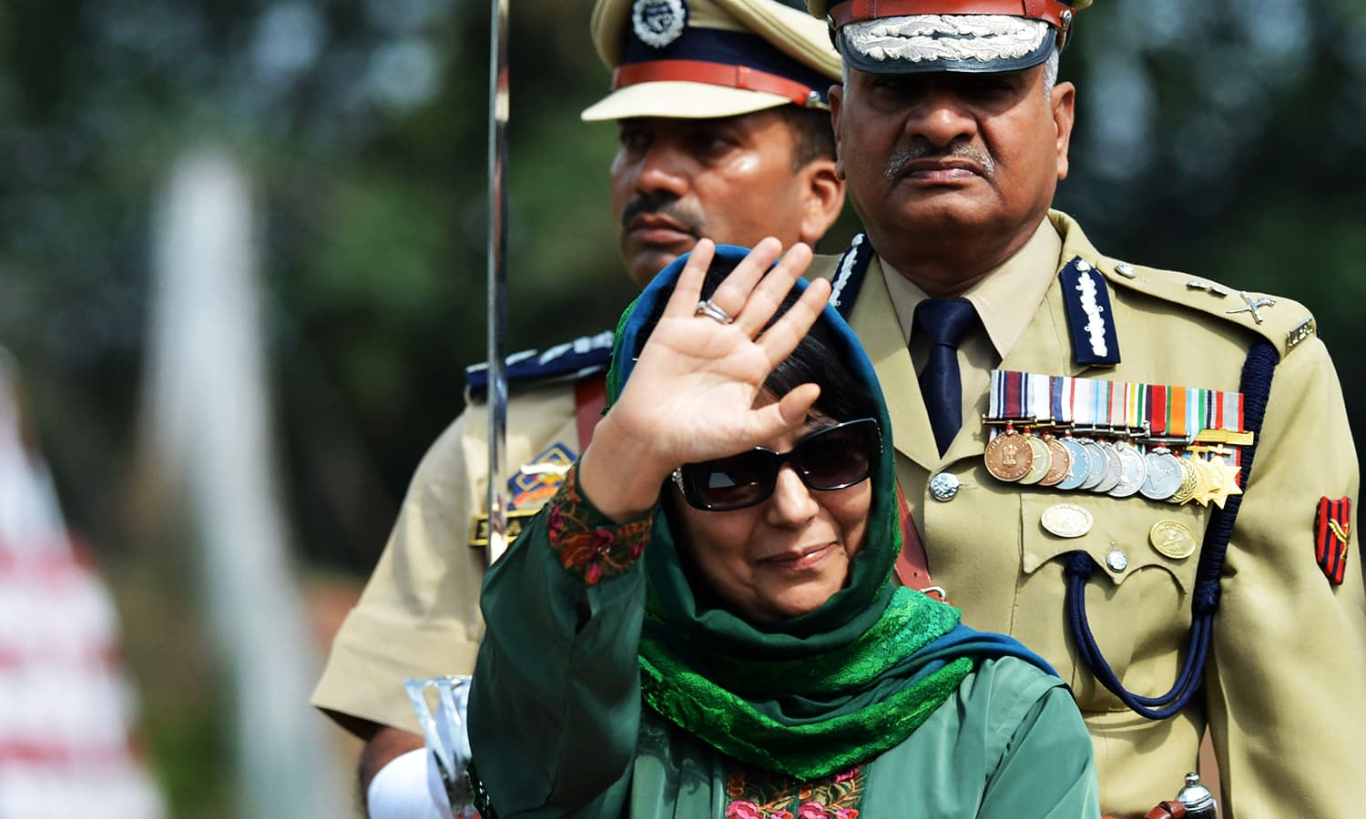 IHK Chief Minister Mehbooba Mufti waves during celebrations marking Independence Day at The Bakshi Stadium in Srinagar. — AFP